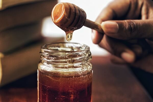 Eating a spoon of honey